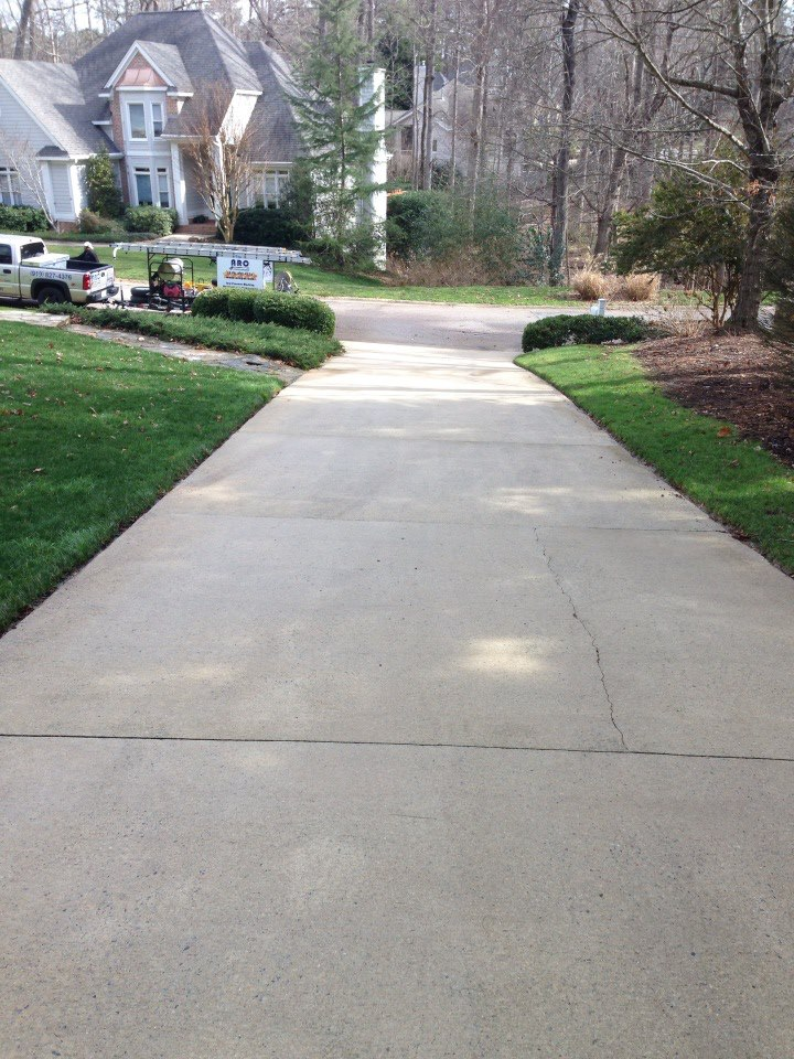 Driveway concrete cleaning pressure washing raleigh for Cement driveway cleaner